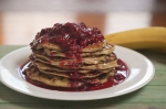 Buttermilk pancakes with raspberries and honey