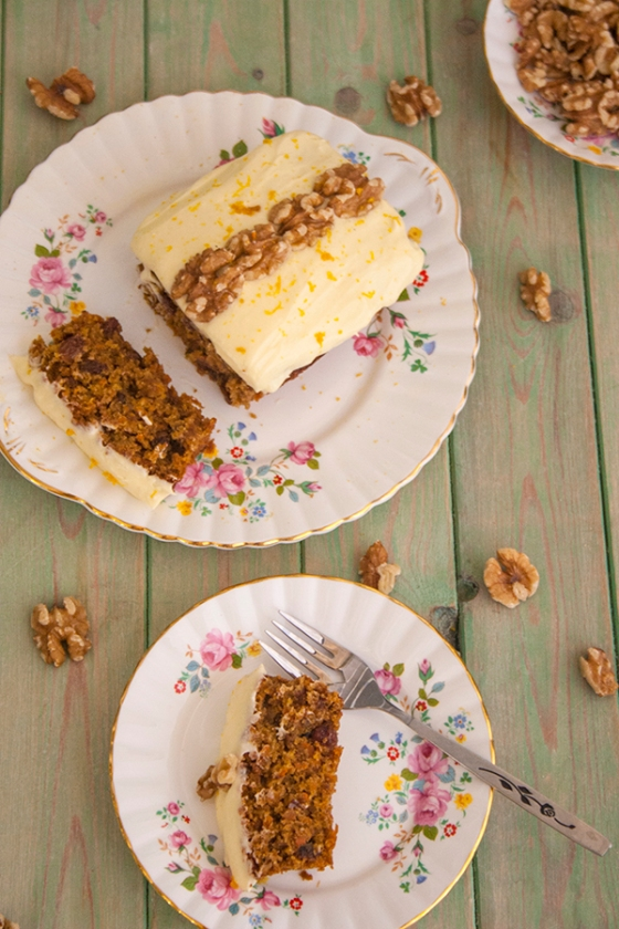 Carrot and orange cake slice with cream cheese icing and walnuts